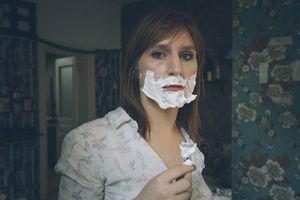 trans woman shaving