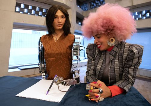 "Artist Sadie Clayton (R) is seen with ""Ai-Da"", the first ultra-realistic robot artist."