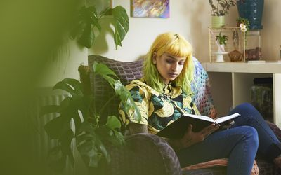 Hipster woman reading
