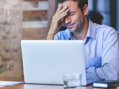 man looking stressed at computer