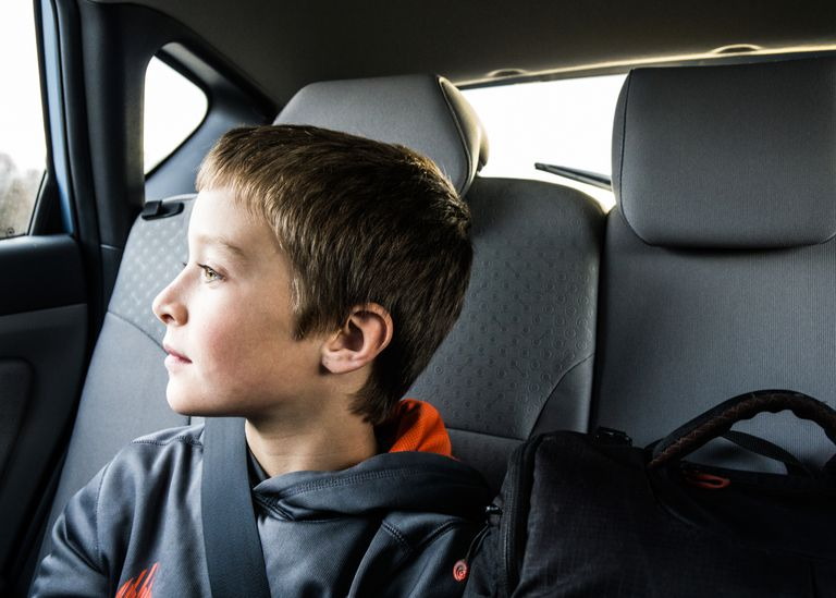 boy (10yrs) looking out car window