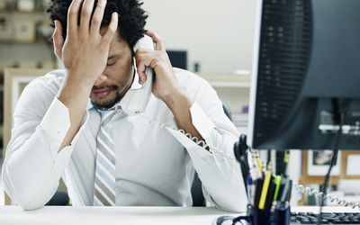 African American man sitting at desk