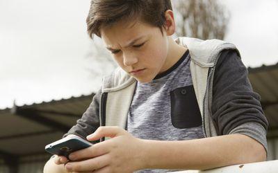 anxious boy on phone