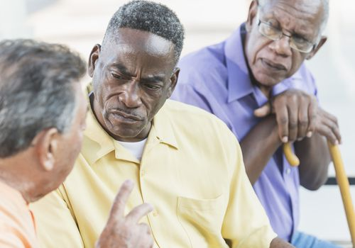 Older men in tense discussion
