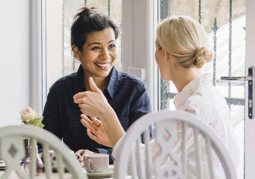 two women enjoying coffee