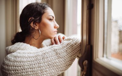 Pensive woman staring out the window