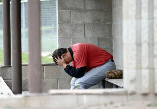 Dejected Baseball Player in dugout