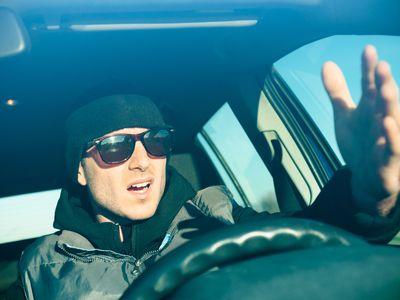Stressed furious man driving his car