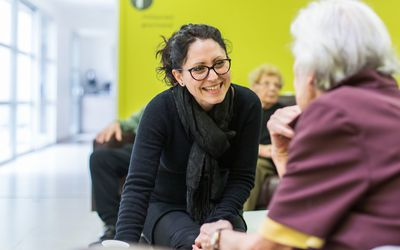 psychologist talking to elderly person