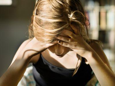 Teenage girl in despair over empty plate