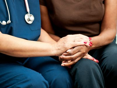 Woman holding nurse's hand