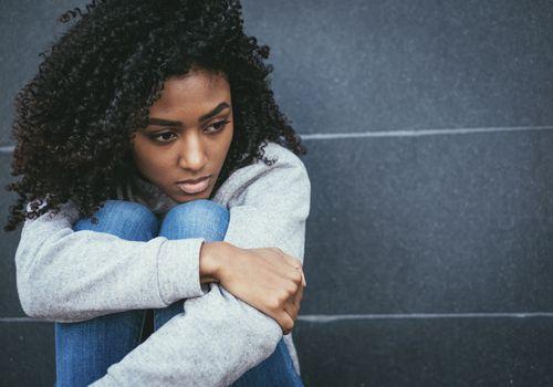 Sad young black woman portrait feeling negative emotions