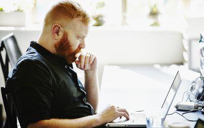 Businessman at workstation in startup office