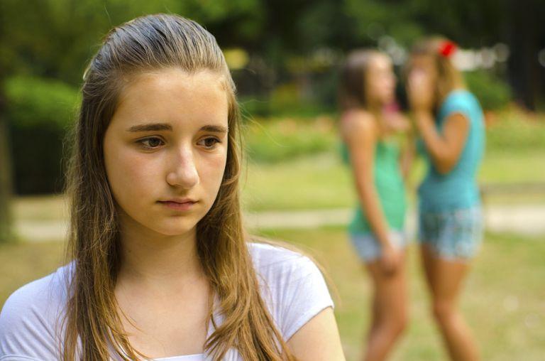 Sad teen being bullied