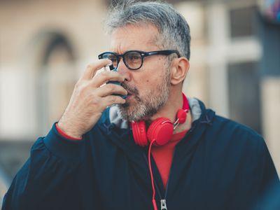 Man with COPD using an asthma inhaler