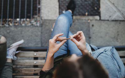 woman rolling cigarette
