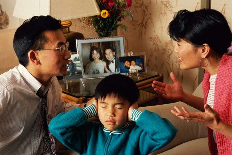 CHINESE MAN & WIFE ARGUING IN FRONT OF CHILD
