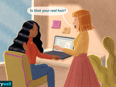 A black woman experiencing microaggressions in the workplace