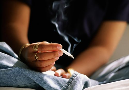 woman's hand holding a joint