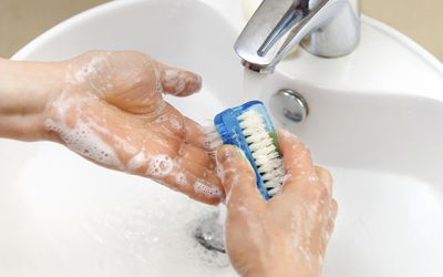 A person with OCD washing their hands