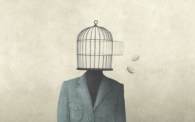 Man with open birdcage over his head, surreal freedom concept