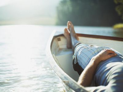 Man Floating in Boat