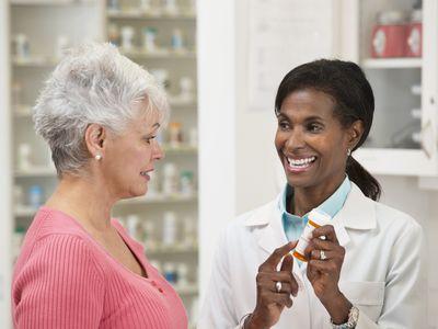 Pharmacist serving customer in pharmacy