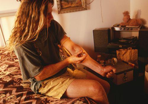 man injecting