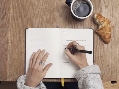 Woman writing to-do list