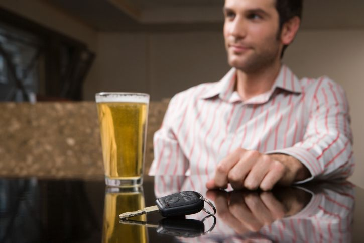 Man With Beer and Keys