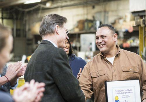 man receiving employee of the month award