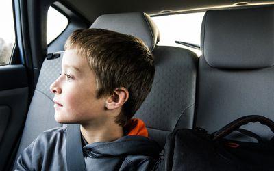 boy (10yrs) looking out car window