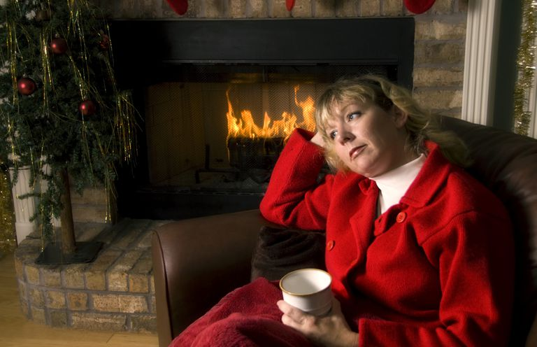 Woman in front of the fire