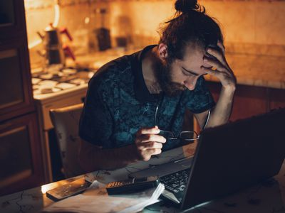 man looking upset searching for a job on the computer