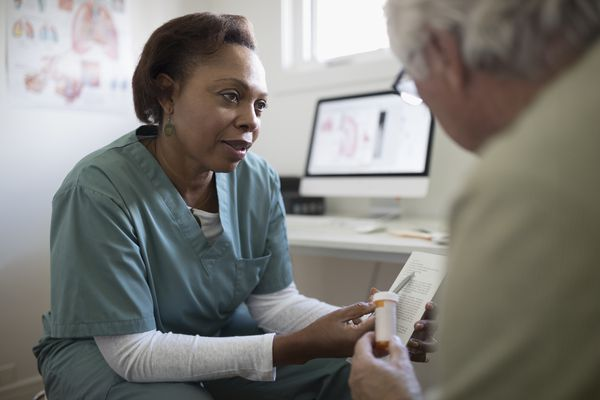 doctor talks to a patient about a medication