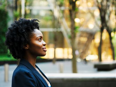 Business woman sitting and thinking positive thoughts