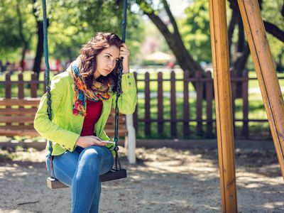 Young woman sitting alone and depressed