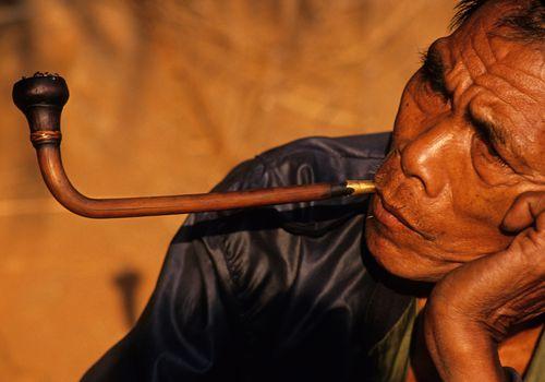 Man smoking opium