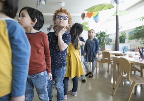 Preschool students lining up in classroom