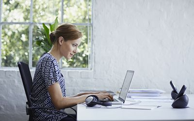 Applied psychologist working on computer
