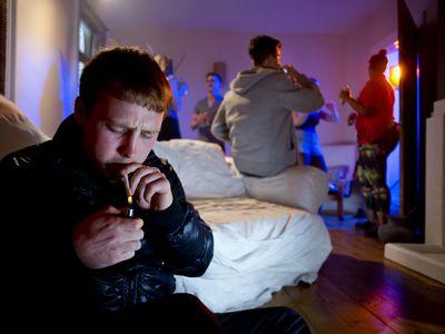 Man Lighting Marijuana Cigarette
