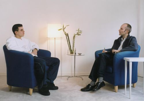 Man Sits With Therapist