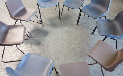 Empty chairs in a circle for AA meeting