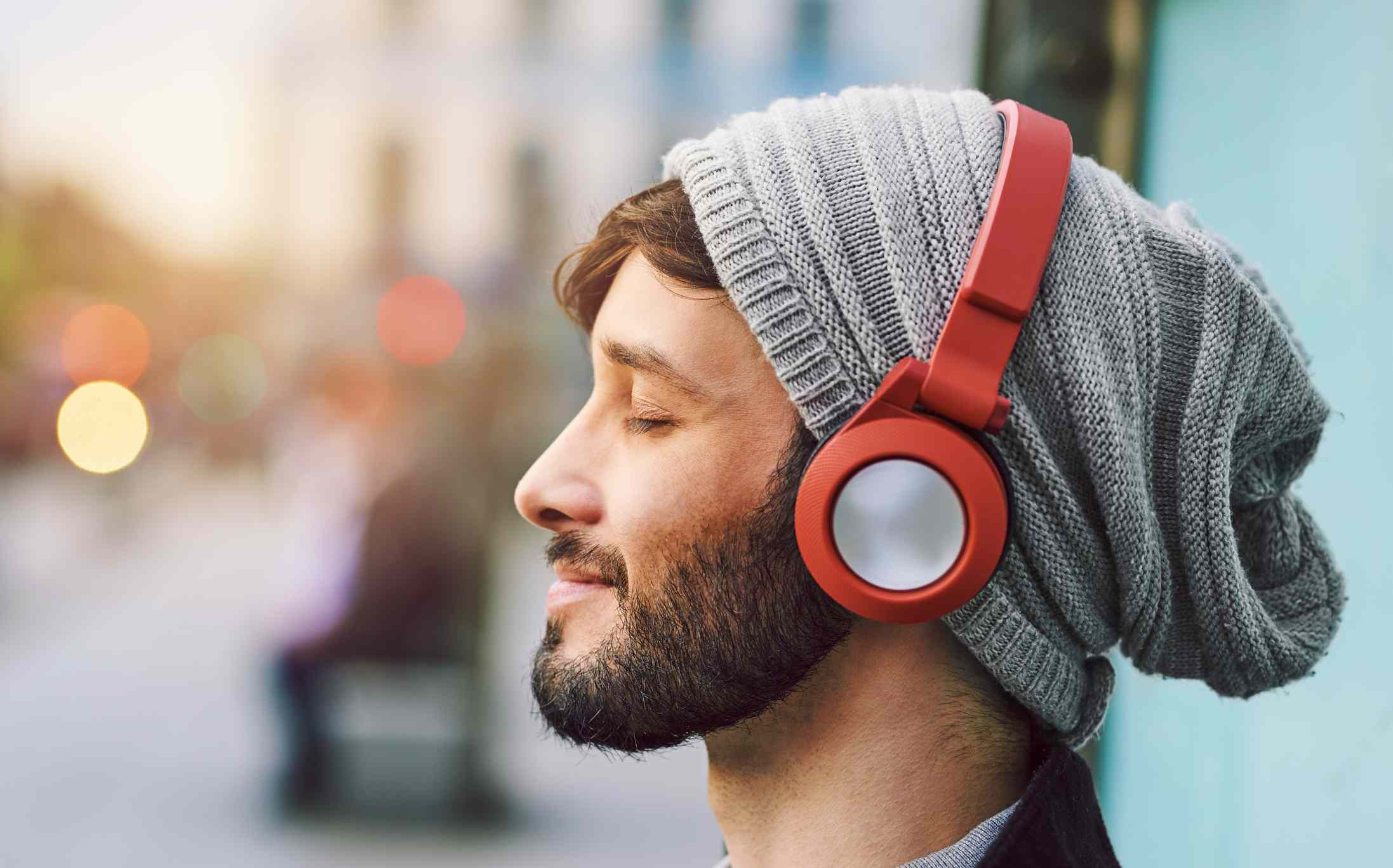 Young man listening to music on his headphones