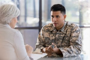 young man talks with his psychologist