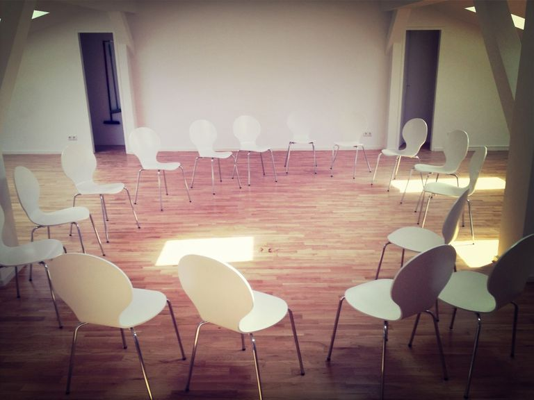 Chairs in a circle in an empty room
