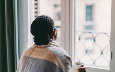 Sad BIPOC woman looking out the window