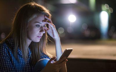 Upset woman looking at smartphone