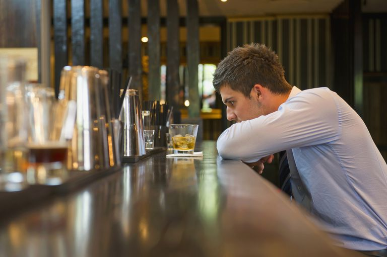 Lonely businessman sitting at bar