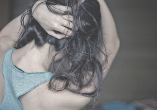 Faceless portrait of woman with beautiful hair